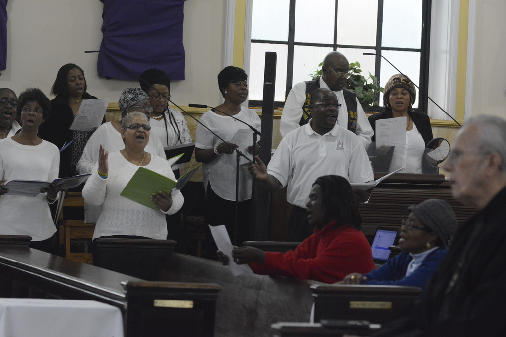 Choir members raise their voices in song at the Revive mission March 21 at SS. Philip and James parish, the Bronx.