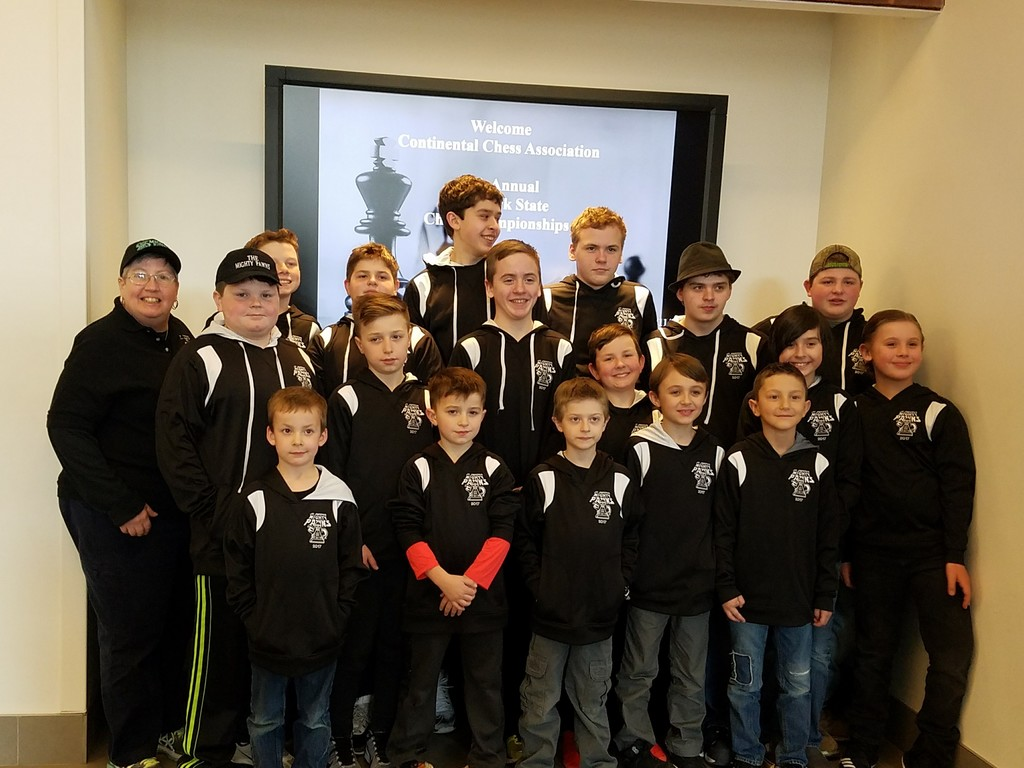 Karen Merker, coach, and members of the Mighty Pawns chess team from St. Joseph's School in Kingston, looked sharp in their black and white hoodies at the New York Chess Championships in Saratoga Springs.