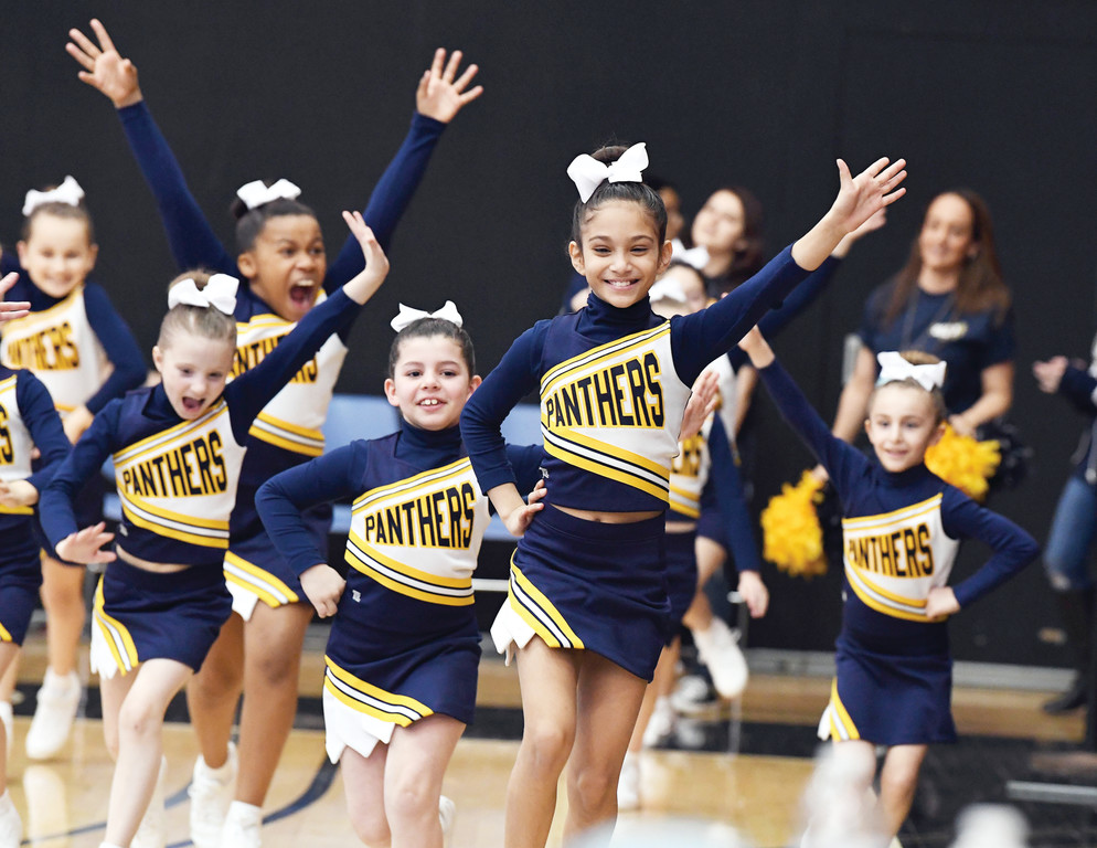 Cheerleaders from Our Lady Queen of Peace are introduced at the archdiocese's CYO Cheerleading Championships at the College of Staten Island March 25.