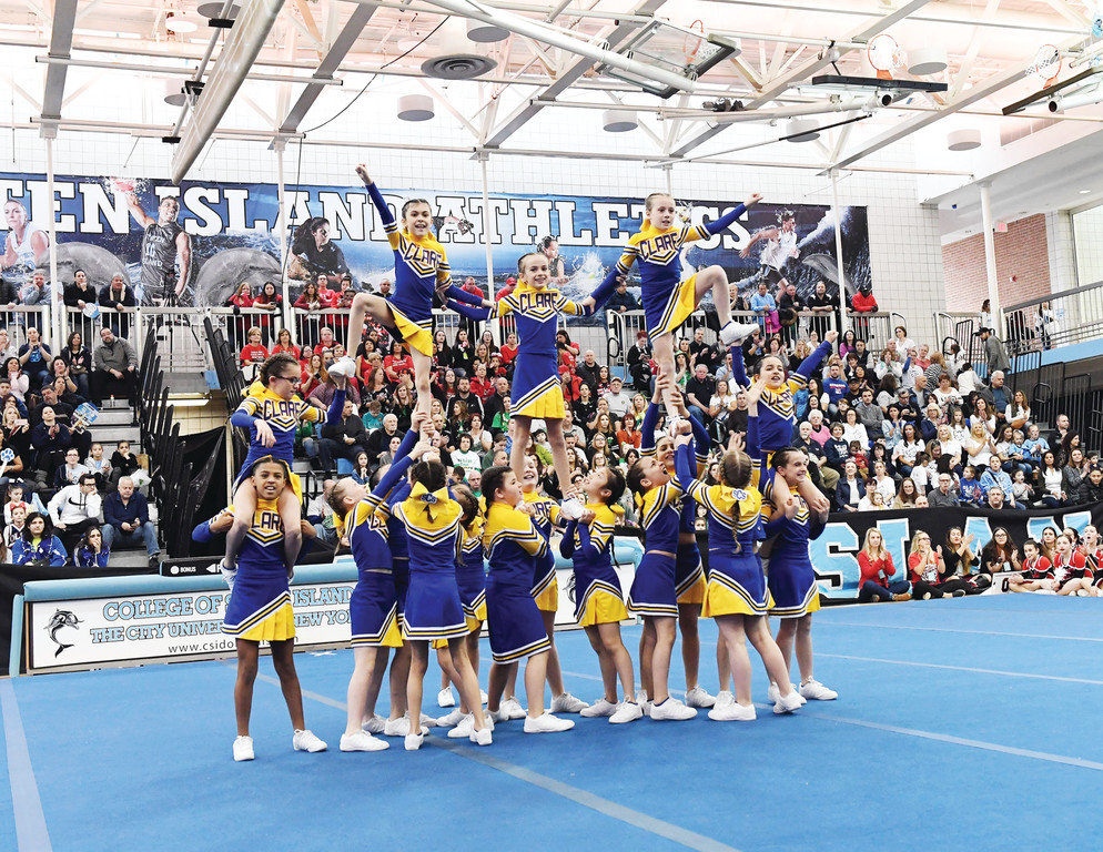 St. Clare cheerleaders build a human pyramid.