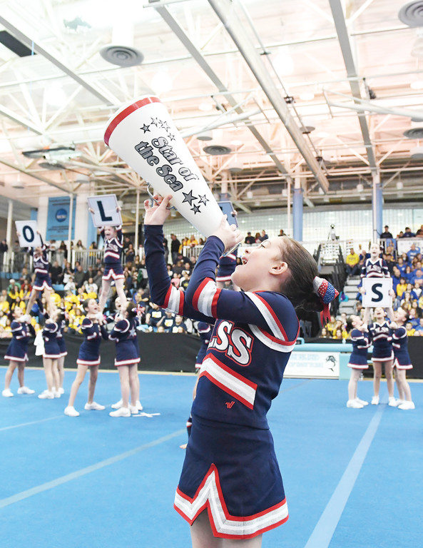 Our Lady Star of the Sea, Staten Island, brought sights and sounds to a first-place performance in the Debs Division at the CYO cheerleading championships at the College of Staten Island March 25.