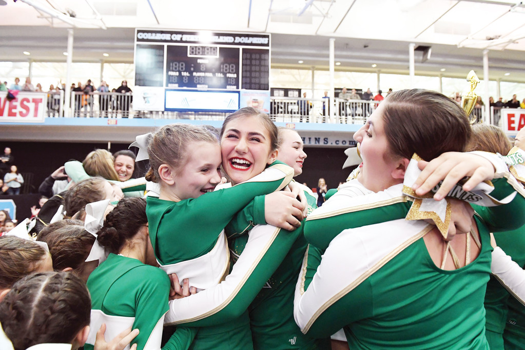 St. Joseph-St. Thomas cheerleaders celebrate winning the Varsity Division.
