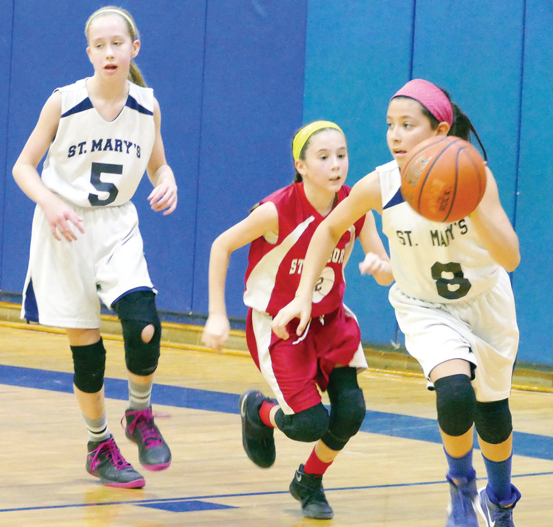 Sela Halaifonua dribbles the basketball for St. Mary of the Assumption.