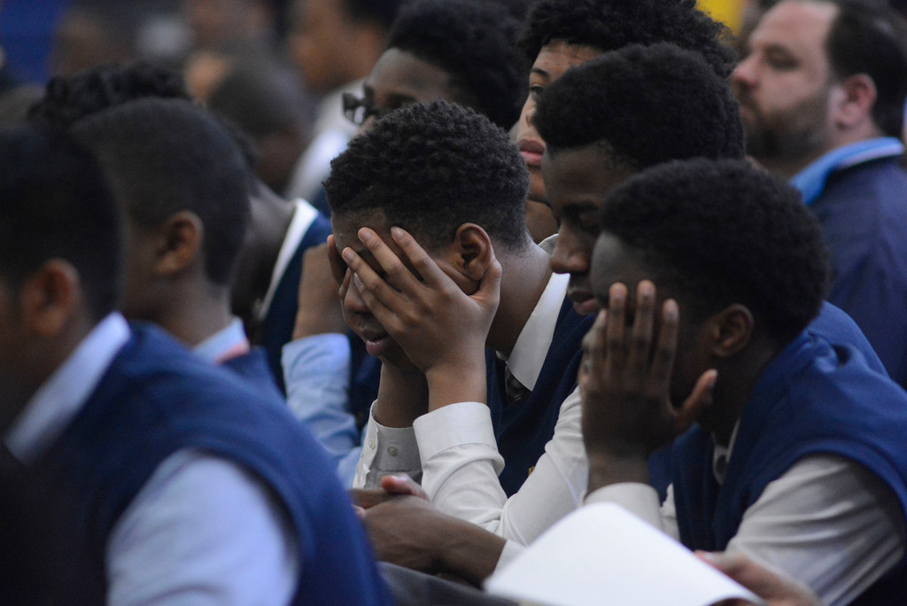 Students pray during the morning Mass March 27.