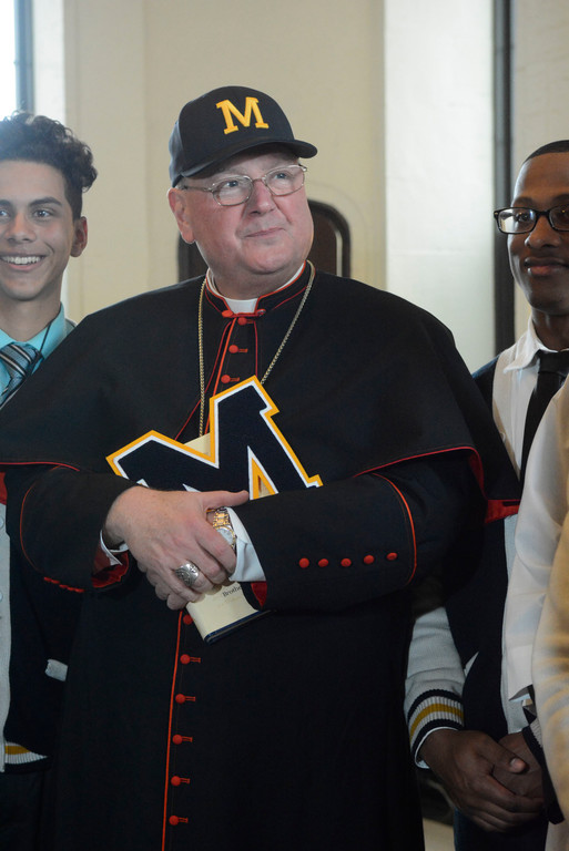 Cardinal Dolan fits right in with Mount St. Michael cap and varsity letter.