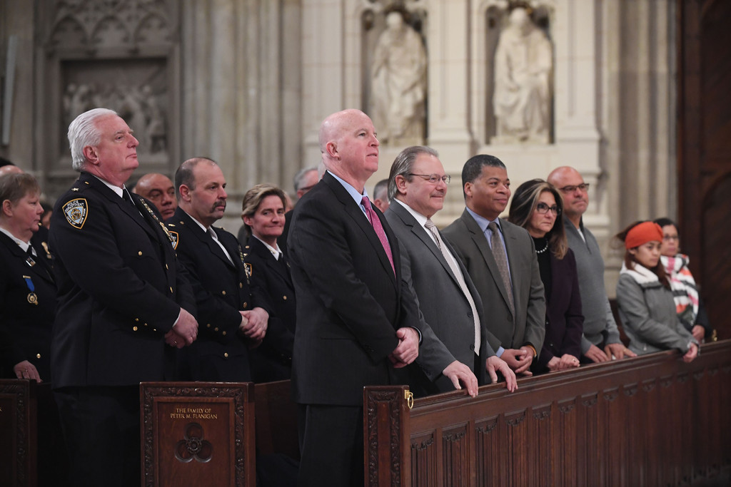 Other attendees included NYPD Commissioner James O'Neill. Middle, officers file past Cardinal Dolan, the principal celebrant, as they enter the cathedral.