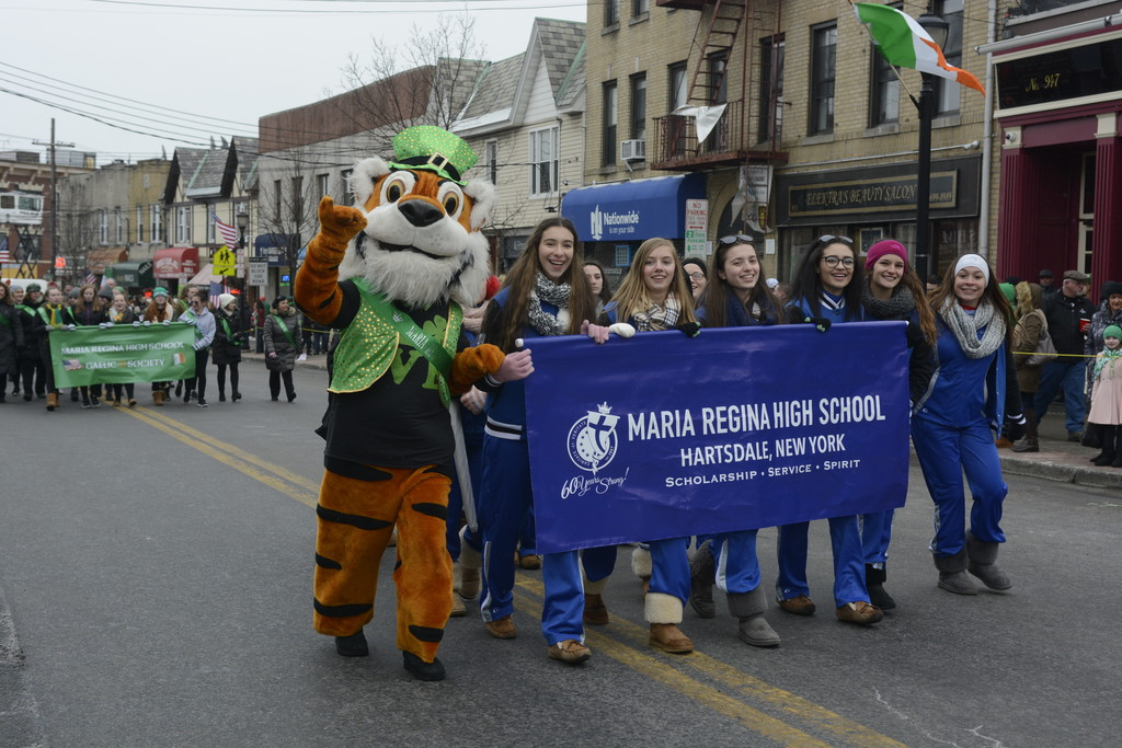 The mascot from Maria Regina High School in Hartsdale walks with students.
