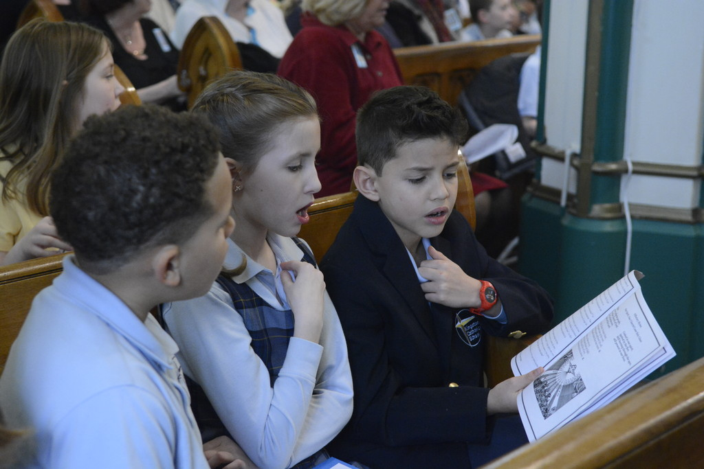 Kingston Catholic School students sing at Mass.