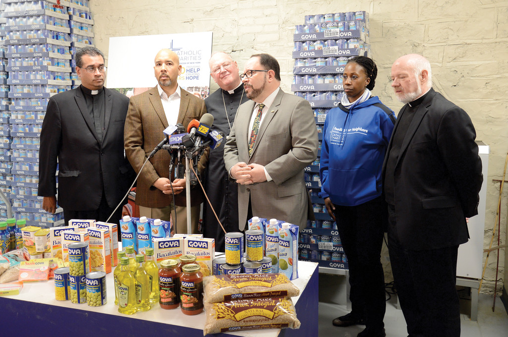 At the Bronx Food Hub, Cardinal Dolan joins Father Eric Cruz, Catholic Charities' Bronx director; Bronx Borough President Ruben Diaz Jr.; and Robert Unanue, president/CEO of Goya Foods.