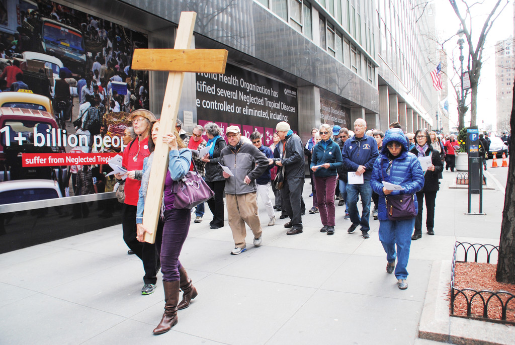 Pilgrims walk on 42nd Street in Pax Christi Metro New York's 35th Way of the Cross on Good Friday, April 14.