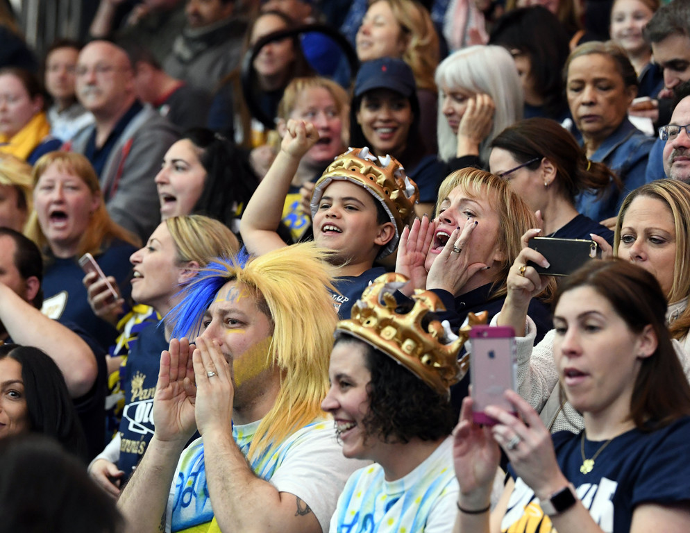 Our Lady Queen of Peace fans cheer for their Debs with inflatable crowns.