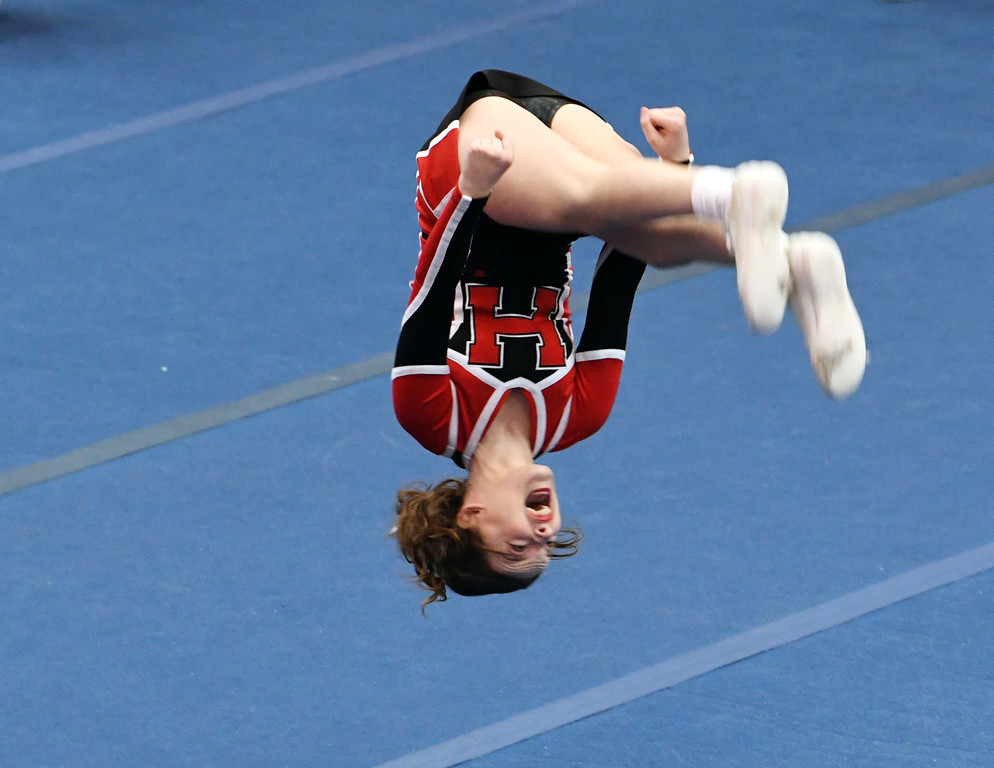 Holy Child Varsity member flips during her routine.