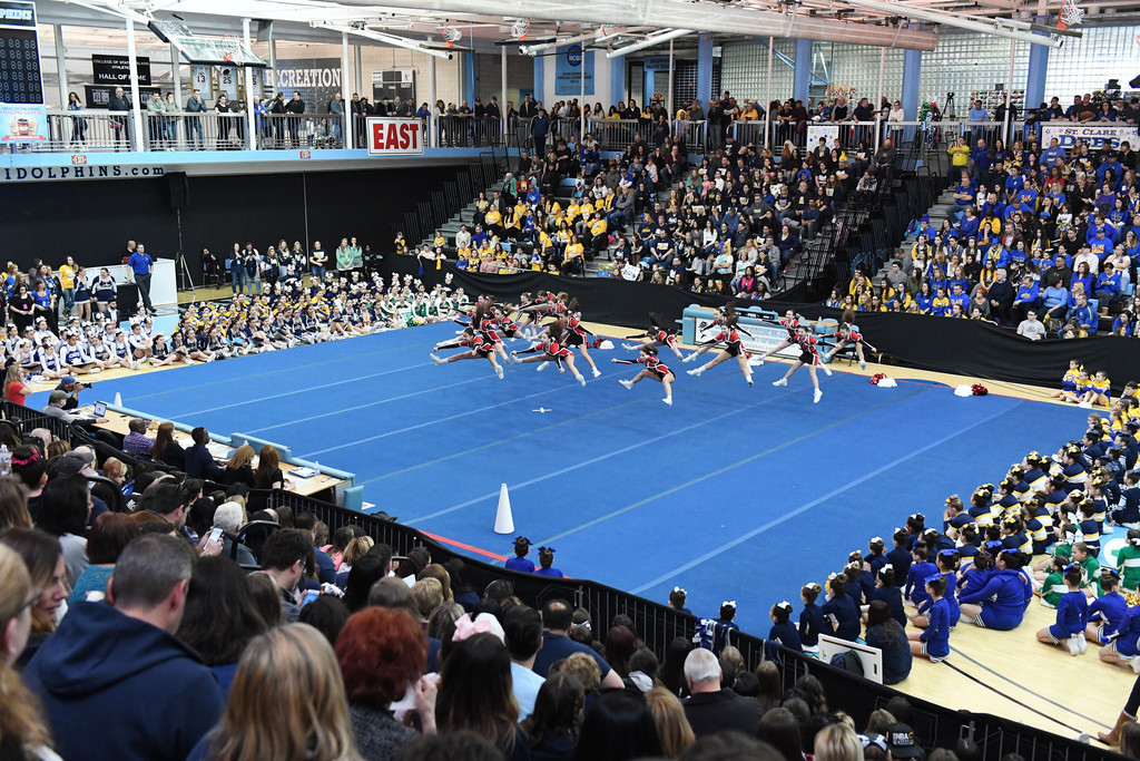 General view of the sold out afternoon competition.  Holy Child Varsity is leaping on the mat.