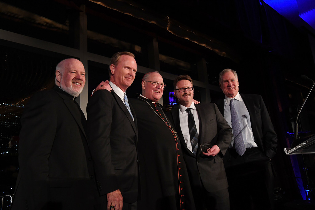 New York Giants head coach Ben McAdoo, second from right, receives the John V. Mara Sportsman of the Year Award at the 81st annual CYO Club of Champions Tribute at the Mandarin Oriental in Manhattan May 2. Standing with McAdoo, are, from left, Msgr. Kevin Sullivan, executive director of Catholic Charities; Giants co-owner John Mara; Cardinal Dolan; and Chris Gallagher, president of the CYO board of directors.