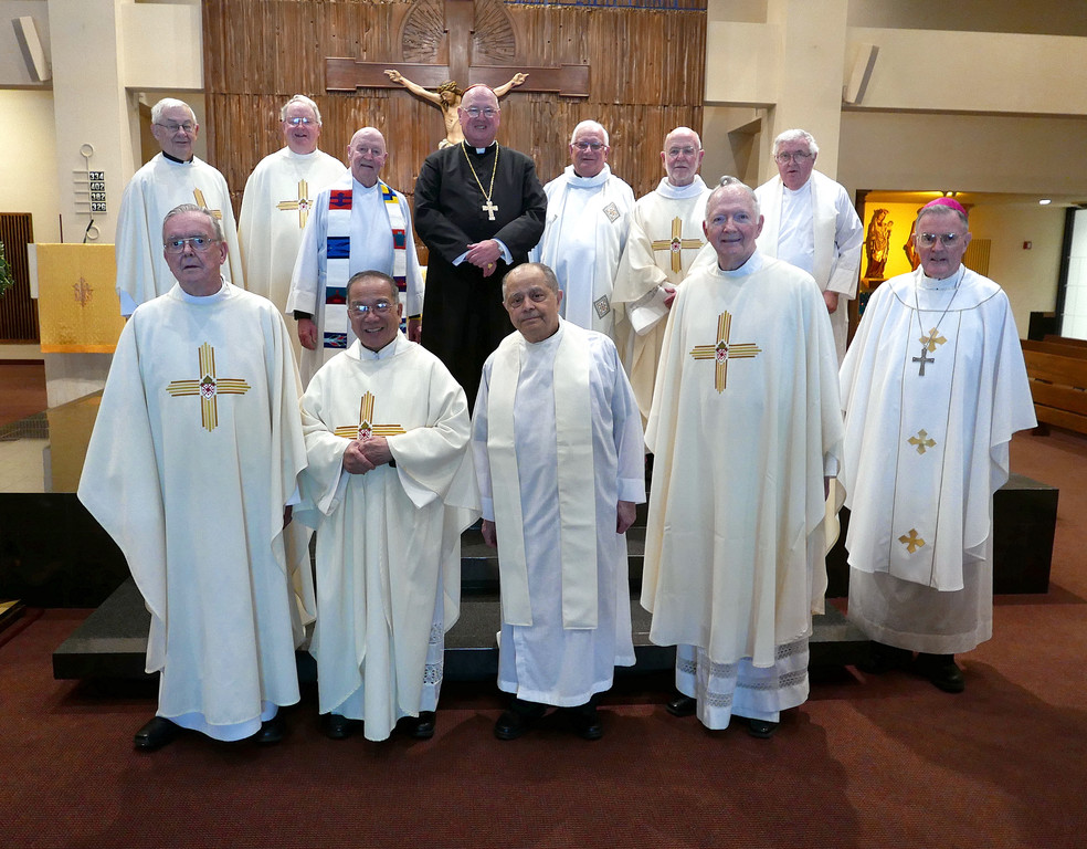 50 YEARS OF PRIESTHOOD—Cardinal Dolan joins the priests of the archdiocese who are marking their golden jubilees this year at St. John the Evangelist Church in Manhattan, where they concelebrated a Mass of Thanksgiving May 10. Front row, from left: Msgr. Thomas Gilleece, Msgr. Peter Tran Van Phat, Msgr. Joseph Penna, Msgr. James Moore and Auxiliary Bishop Gerald Walsh. Back row, from left: Msgr. Joseph Martin, Msgr. Thomas Kelly, Father James Borstelmann, Cardinal Dolan, Father Martin Biglin, Father Peter Bannan and Msgr. William Foley. Not pictured, Father Virgilio Competente, Father Karl Bauer, Father John Durkin and Msgr. John Meier.