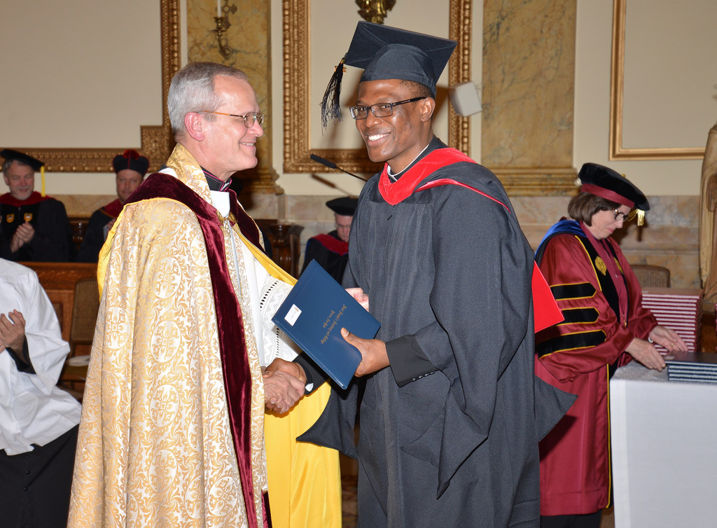 Ikenna Ikagbue receives his degree.
