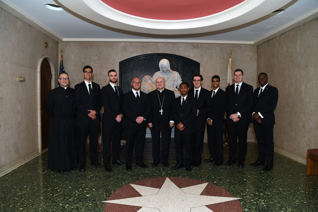 Members of the class of 2017 from the Archdiocese of New York pose at the convocation of the Cathedral Seminary House of Formation at Immaculate Conception Center in Douglaston, Queens, May 12. From left are Father George Sears, rector; Brandon Miraz; Niall McDonagh; Robert Carolan; Auxiliary Bishop James Massa of Brooklyn; Wesbee Victor; Anthony Gorgia; Savio Paul; Matthew Breslin; and Tegawende Stephane Ovedraogo. Not pictured is graduate Carmine Caruso.
