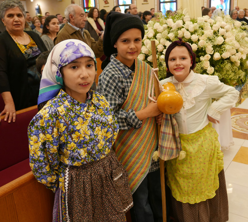 Portraying the shepherd children who were the seers of the Marian apparition in Fatima, Portugal, beginning May 13, 1917, are, from left, Sophia Campos, Leonardo Ferreira and Liliana Ferreira.