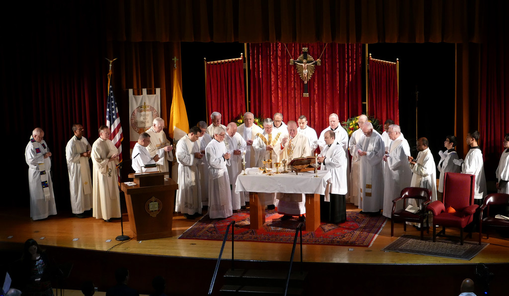 Cardinal Dolan celebrates Mass in the Regis Philbin Auditorium at Cardinal Hayes High School in the Bronx to mark the 75th anniversary of the school May 18. Six priests assisting the cardinal were Cardinal Hayes graduates.