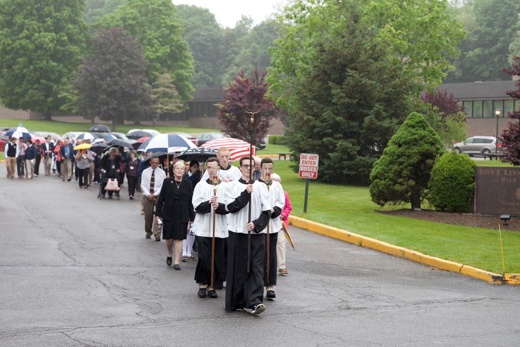A procession leads to the grotto.