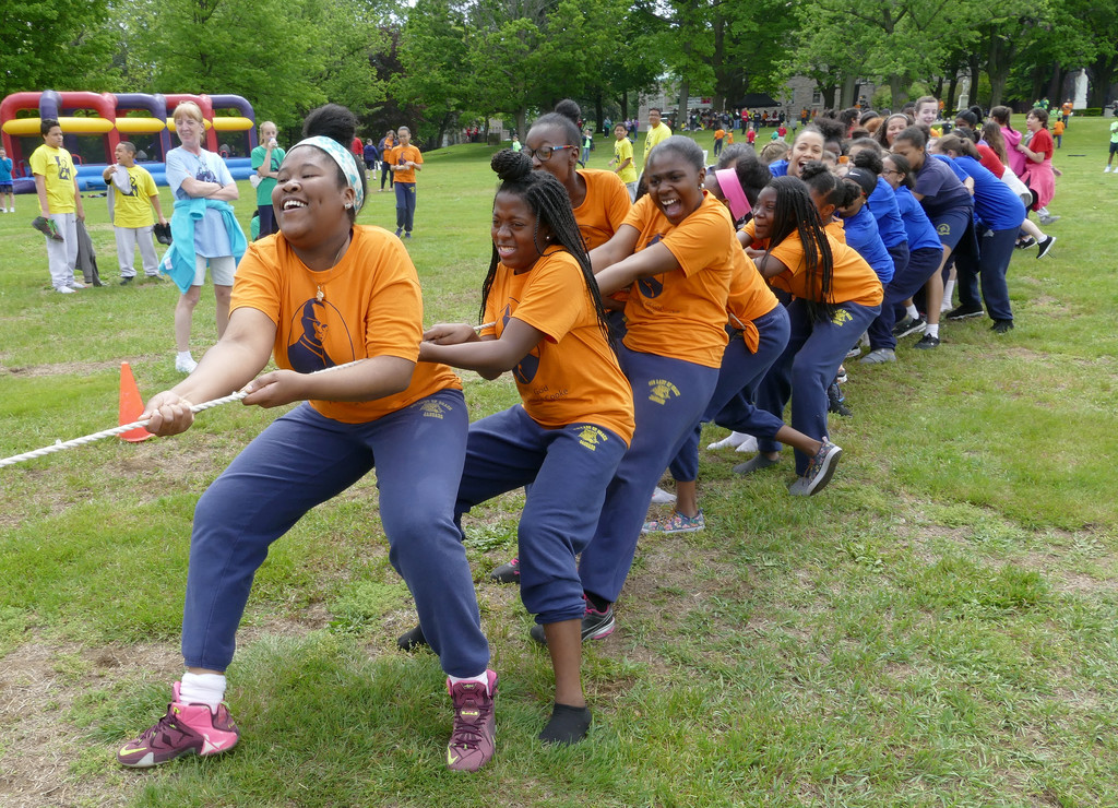 Seventh-graders from Our Lady of Grace in the Bronx lead a tug-of-war.