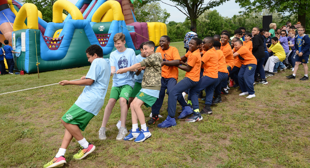 Students from St. Paul the Apostle in Yonkers and Our Lady of Grace steer the tug-of-war rope from the front.