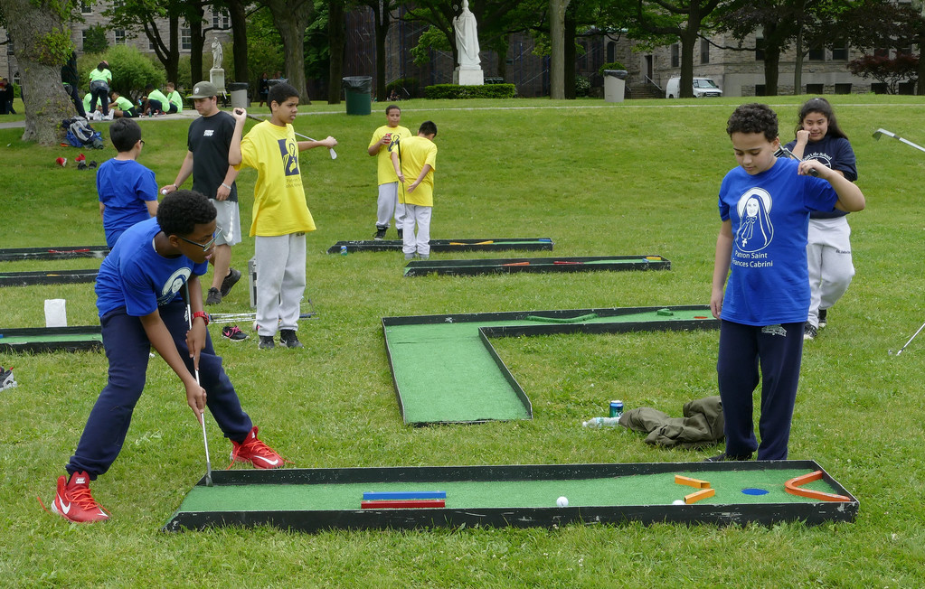 Angel De Leon, left, and Raylee Paulino, both from Incarnation School in Manhattan, enjoy a round of miniature golf.