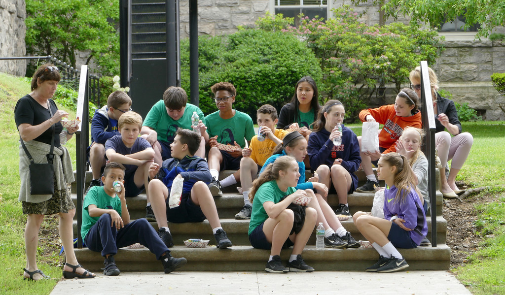 Students take a break for lunch. Mass in the seminary chapel preceded the field day.