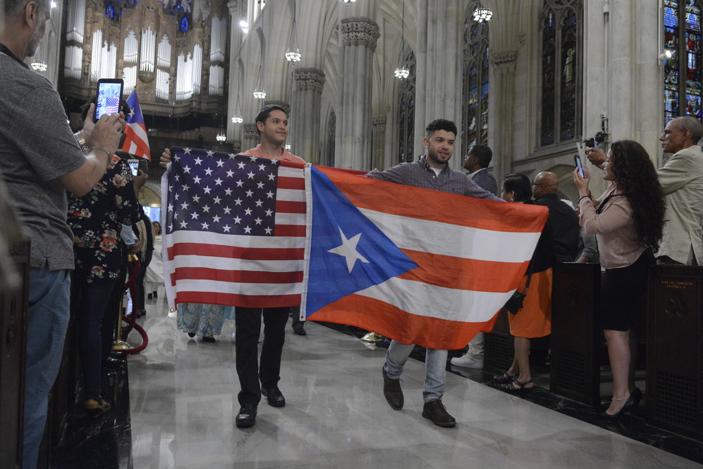 Bearers of flags of the United States and Puerto Rico, process into the Puerto Rican Parade Mass celebrated on Pentecost Sunday, June 4 at St. Patrick's Cathedral.