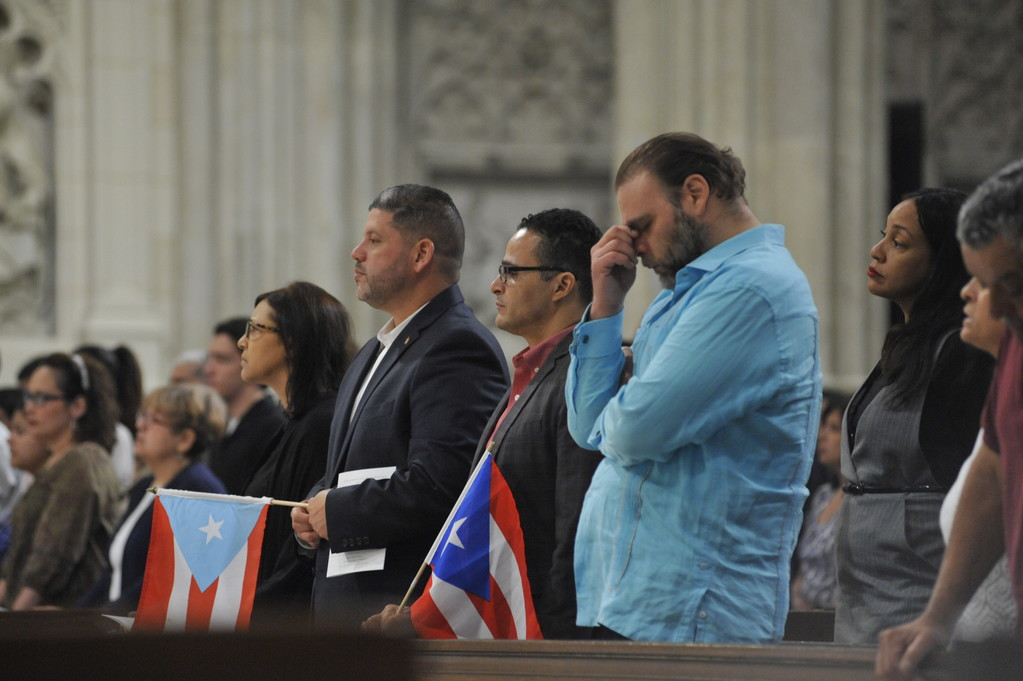 Congregants solemnly pray at the Puerto Rican Parade Mass celebrated on Pentecost Sunday, June 4 at St. Patrick's Cathedral.