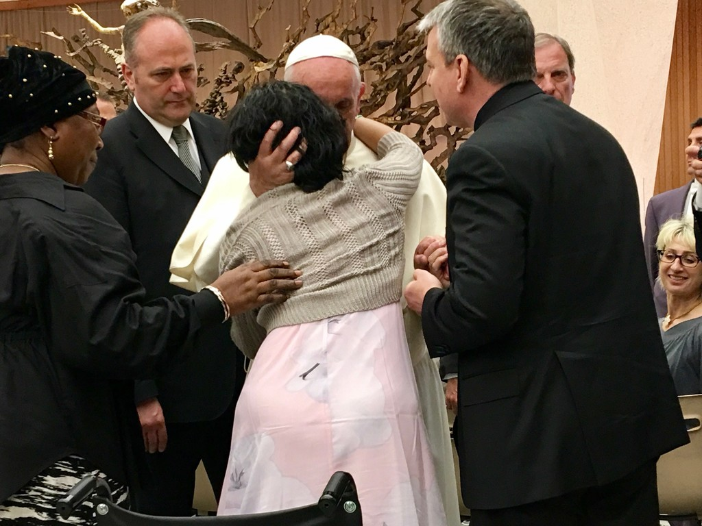 "Ms. Nathan, a 24-year-old with Huntington's disease, hugs Pope Francis. ""As he embraced me, Pope Francis told me that I'm just as holy as he is. He told me to pray for him. It made me speechless when he said that to me,"" Ms. Nathan said."