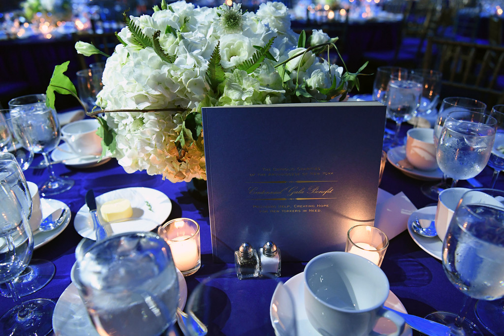 The table was set with white hydrangeas and blue table cloths.