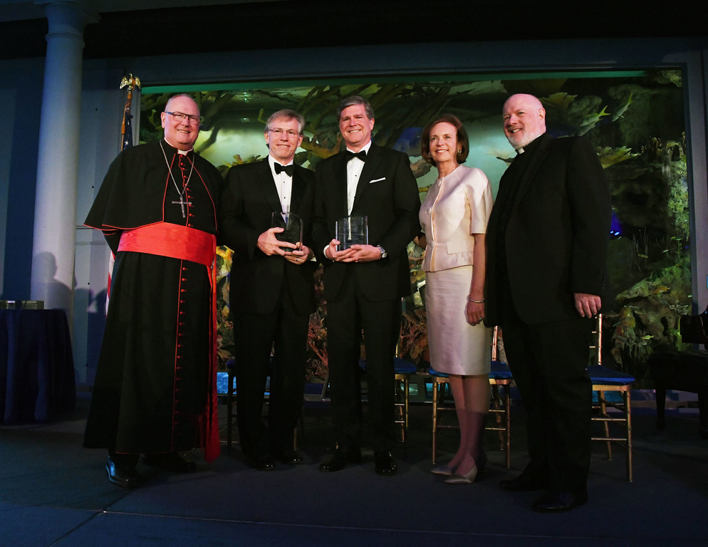 The dignitaries and award recipients gather for a group photo.  