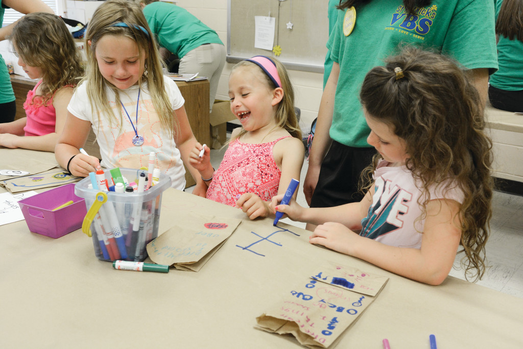 Students last week participate in crafts, a popular activity at the Vacation Bible School at St. Patrick's parish in Highland Mills. Other activities included games, recreation, music and class for the 210 students led by 145 teen volunteers and 68 adult volunteers. The parish has been home to the weeklong school since 2002.