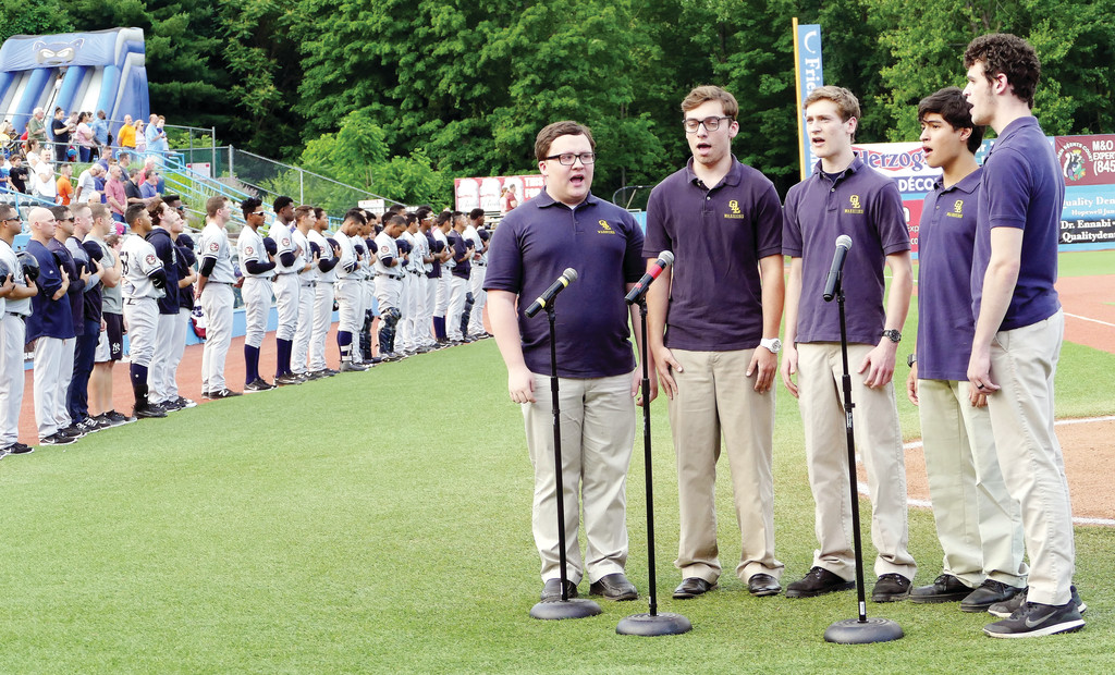 "Our Lady of Lourdes High School students sing ""The Star Spangled Banner."""