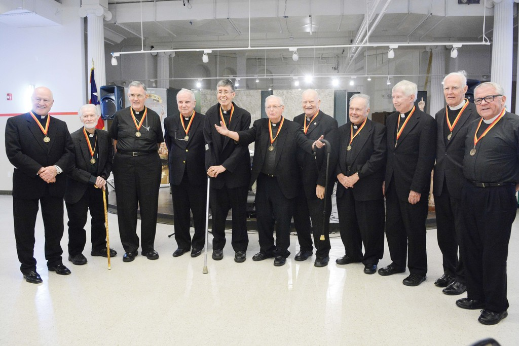 The recipients of the St. John the Baptist Medal are, from left, Msgr. Robert Ritchie, Msgr. Neil Graham, Auxiliary Bishop Gerald Walsh, Msgr. Patrick Carney, Father James Flanagan, Msgr. Francis Gorman, Msgr. Walter Birkle, Msgr. Peter O'Donnell, Msgr. Robert Stern, Father Thomas Fenlon and Father John Duffell.