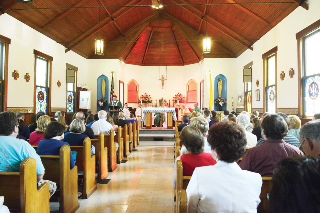 The congregation listens to Father Joseph P. Fallon, pastor of Most Precious Blood and St. Benedict's Chapel, at the Mass celebrating the 100th anniversary of St. Benedict's Chapel in Wallkill July 16.