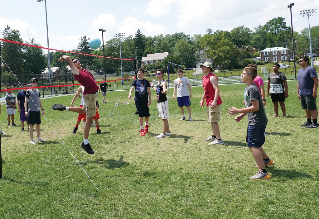 Campers play volleyball at Camp Veritas at Mount St. Mary College in Newburgh July 20. About 500 teens, 100 volunteers and 40 priests, deacons and religious participated in the weeklong camp. Another Camp Veritas will be at Camp Lakota in Wurstboro, Aug. 13-19.