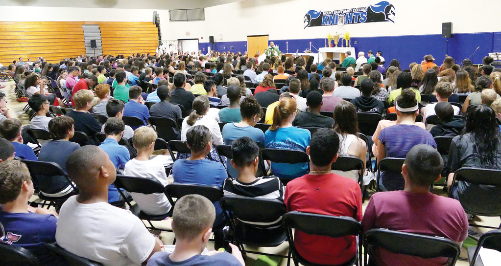Campers attend afternoon Mass inside the gymnasium at the Kaplan Recreation Center.