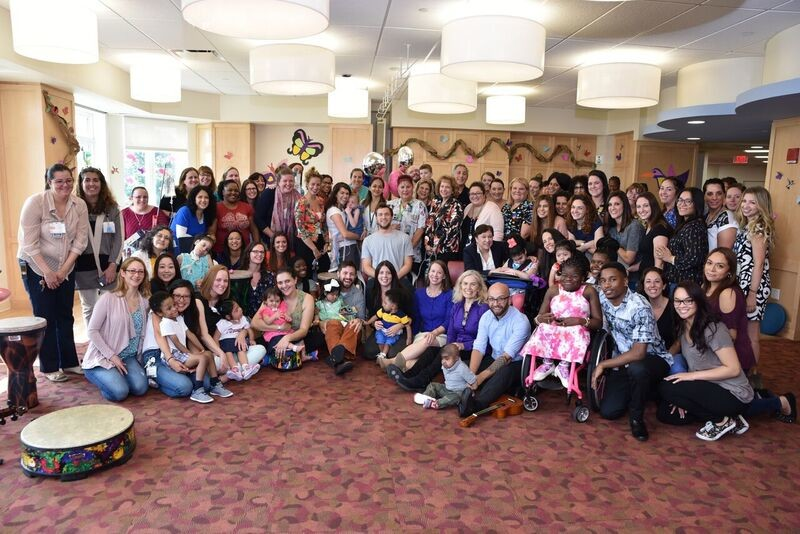 Recording star Phillip Phillips, seated at center, joins residents and staff of the Elizabeth Seton Pediatric Center in Yonkers during his visit Aug. 10.