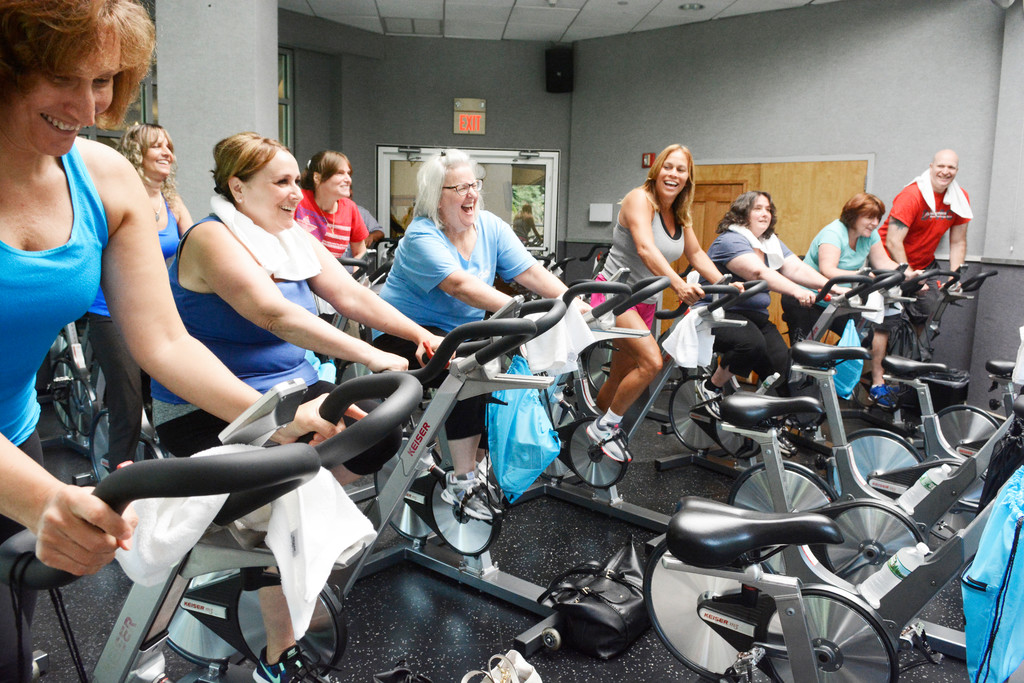 Teachers and administrators from St. Elizabeth Ann Seton School in Shrub Oak enjoy their spin class at Club Fit in Jefferson Valley Aug. 23. Brian Donahue, the school's new principal, arranged the spin class after staff members asked for more team-building activities.