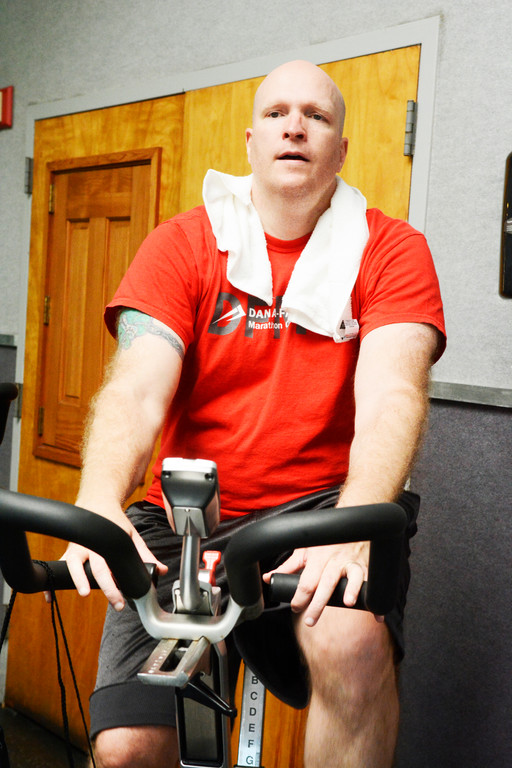 Donahue pedals during the spin class.