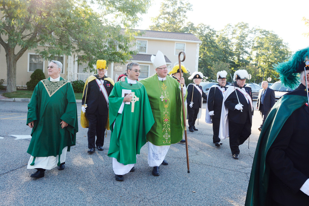 Cardinal Dolan prepares to enter St. Columba with Father Michael McLoughlin, pastor of St. Columba, and Msgr. James Sullivan, far left, dean of Dutchess County and pastor of St. Martin de Porres in Poughkeepsie.