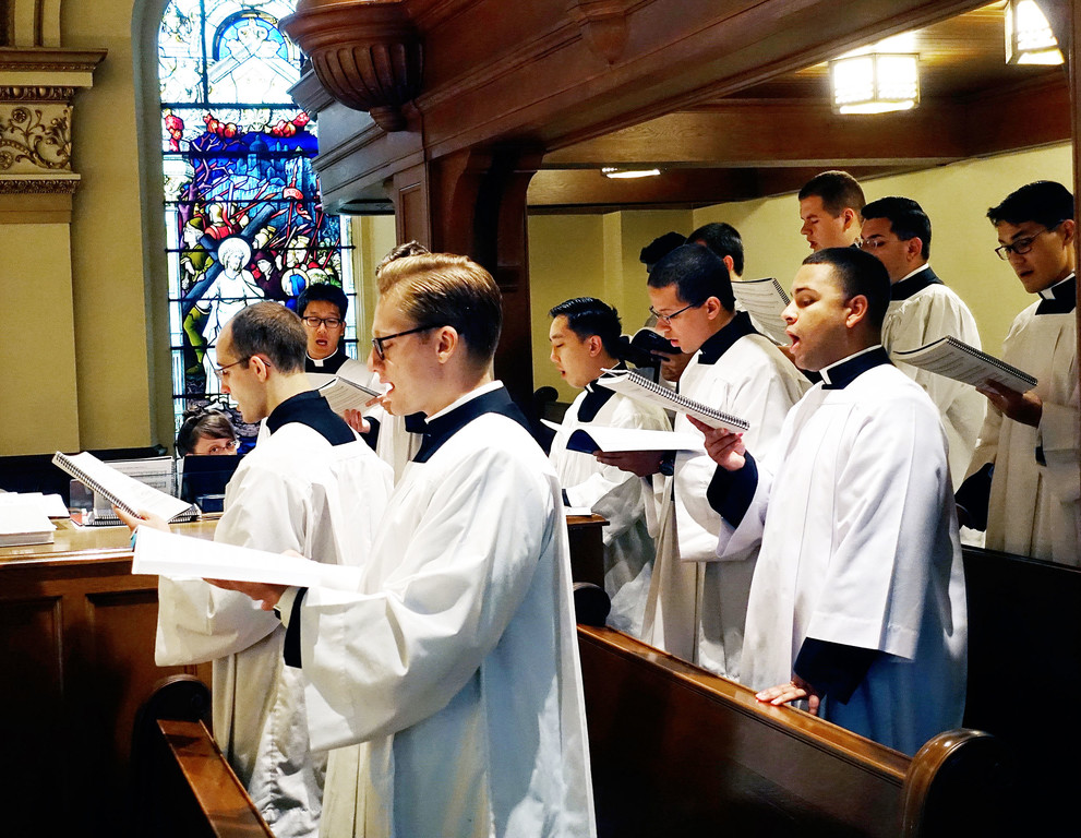 Seminarians sing at the liturgy.