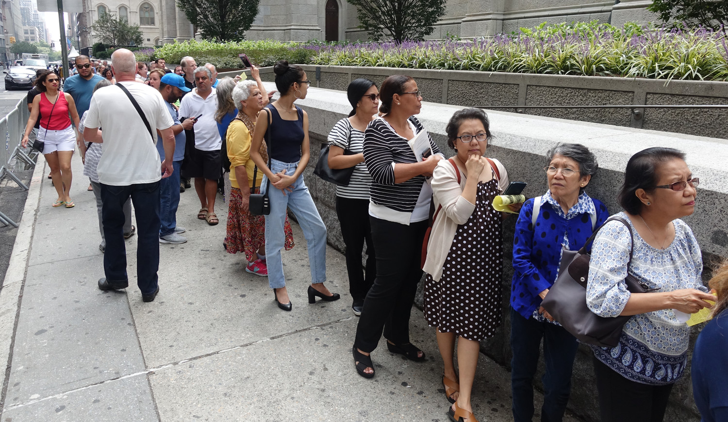 Devotees of St. Padre Pio wait to file into St. Patrick's Cathedral from 51st Street Sept. 17 to venerate relics of the Italian-born saint on display in the Lady Chapel. The line extended around the corner to Madison Avenue, in front of the cathedral's Parish House.