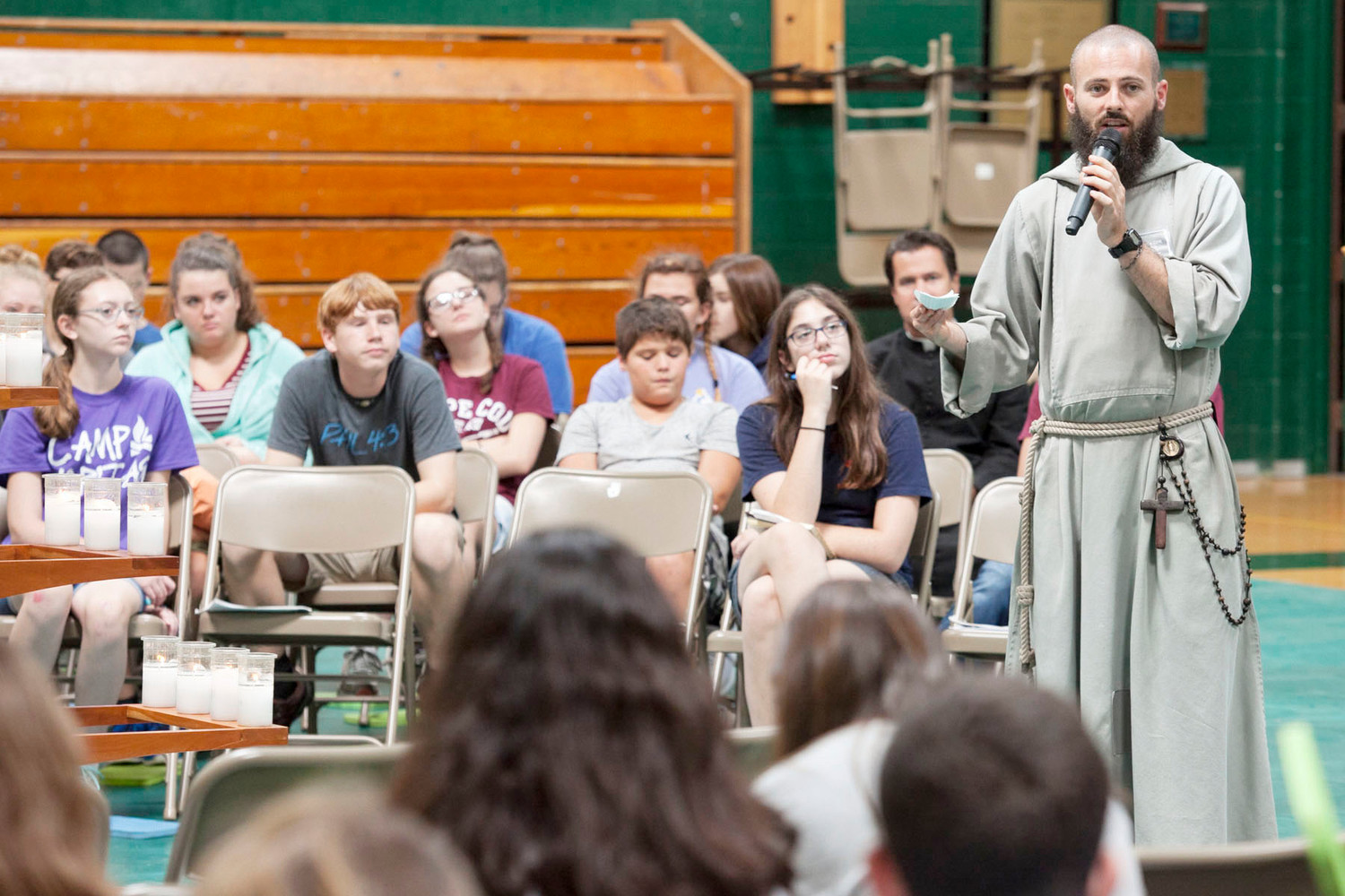 TEEN RETREAT—Brother Benjamin Emmanuel, C.F.R., answers a written question from a camper during a question-and-answer session at the Fearless Retreat at John A. Coleman Catholic High School in Hurley Sept. 16. Brother Emmanuel was on the panel with Father Chris Argano, vocations director for the archdiocese; Matthew Breslin, a seminarian at St. Joseph's Seminary, Dunwoodie; and Jennifer Edwards, executive assistant of Fearless Retreat.