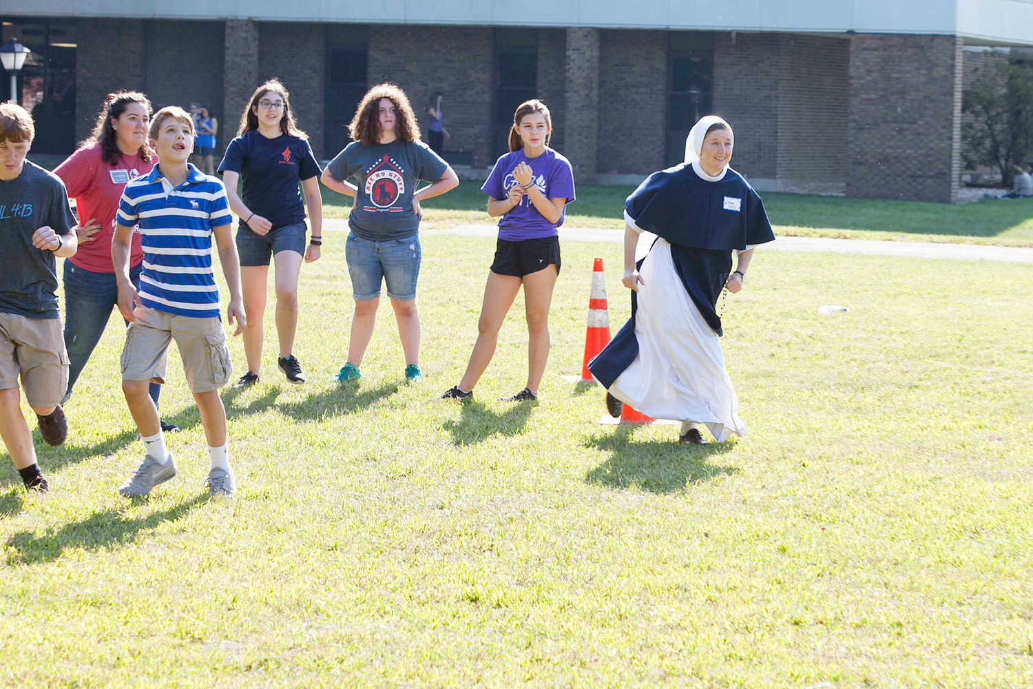 Sister Mary Casey, S.V., joins teens for a game of Frisbee football.