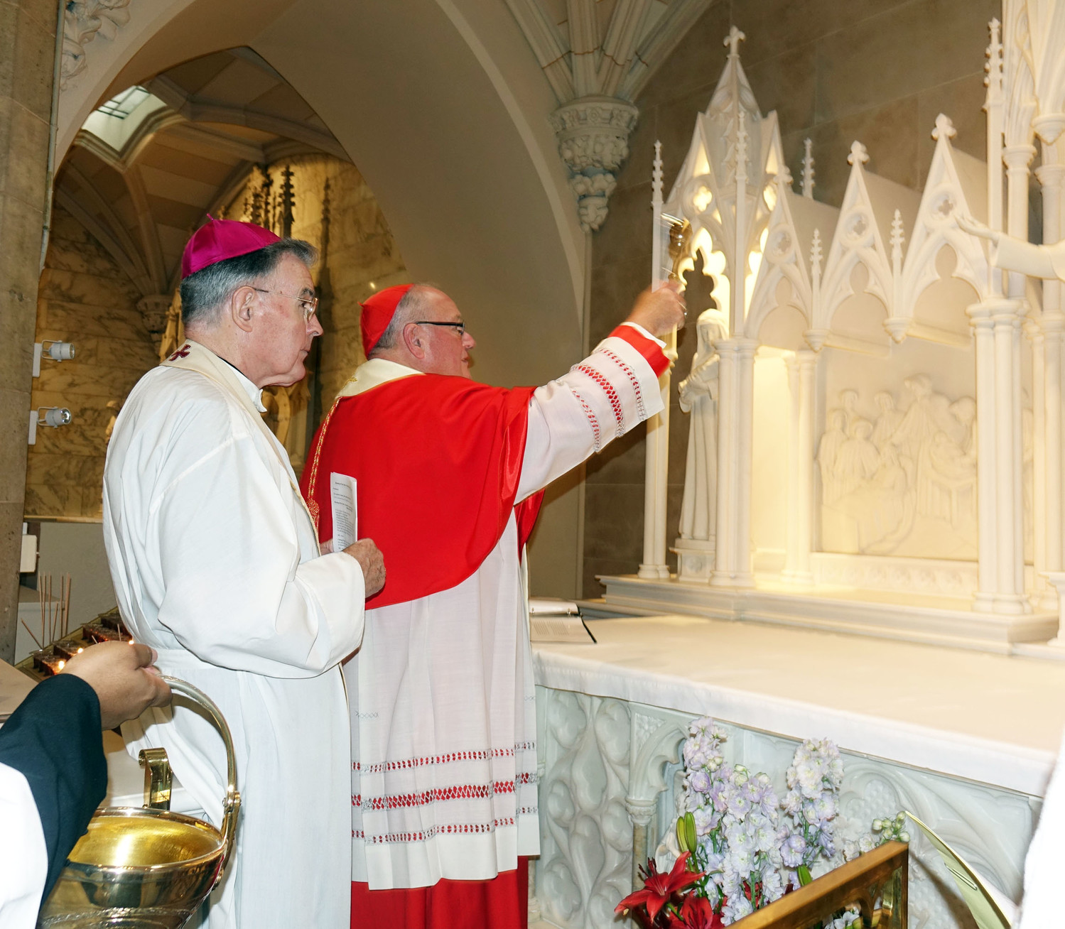 Cardinal Dolan blesses the new Shrine of St. Elizabeth Ann Bayley Seton at an afternoon prayer service at St. Patrick's Cathedral Oct. 8. Behind him is Auxiliary Bishop Gerald Walsh.