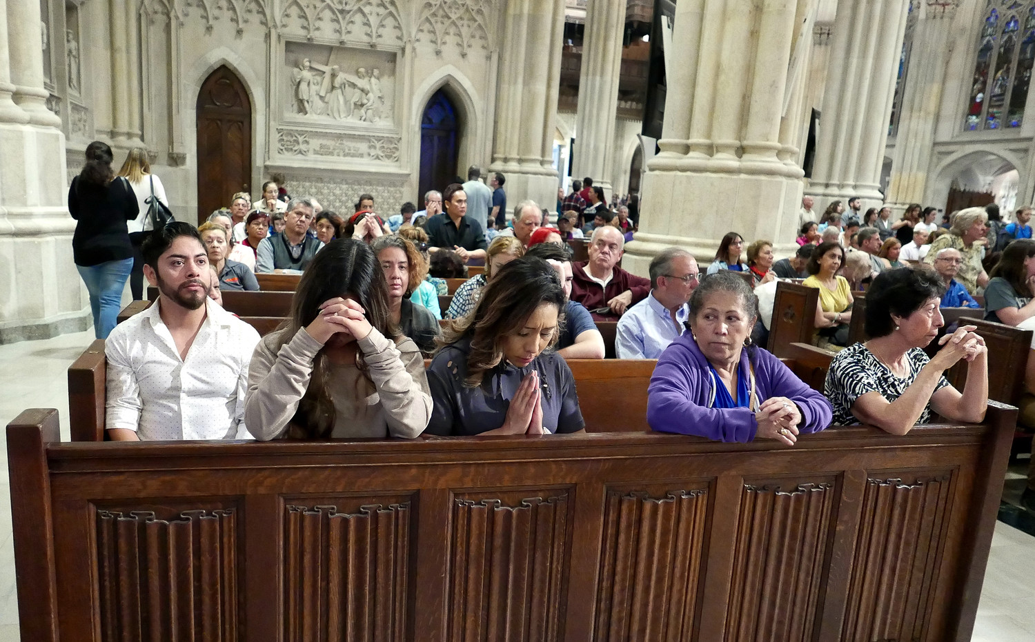 PRAYERS FOR OTHERS—The faithful pray in St. Patrick's Cathedral Oct. 8 at the Disaster Relief Mass Cardinal Dolan offered in Spanish after recent natural disasters in Puerto Rico, Mexico and Central America. More than 1,500 people participated in the afternoon liturgy.