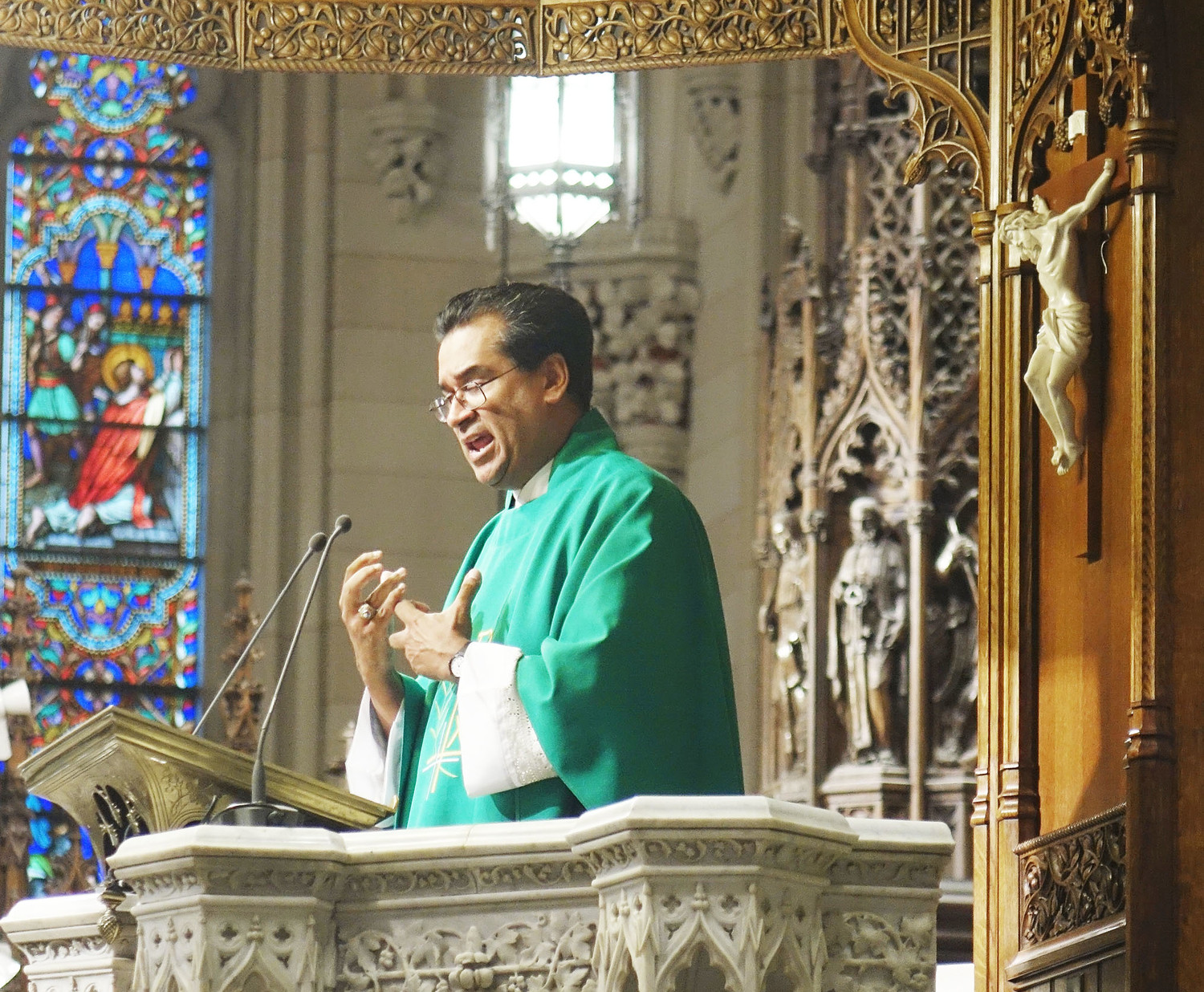 Father Eric Cruz, pastor of St. John Chrysostom parish in the Bronx and the director of Bronx Catholic Charities, preaches his homily. Father Cruz is a New Yorker of Puerto Rican descent.